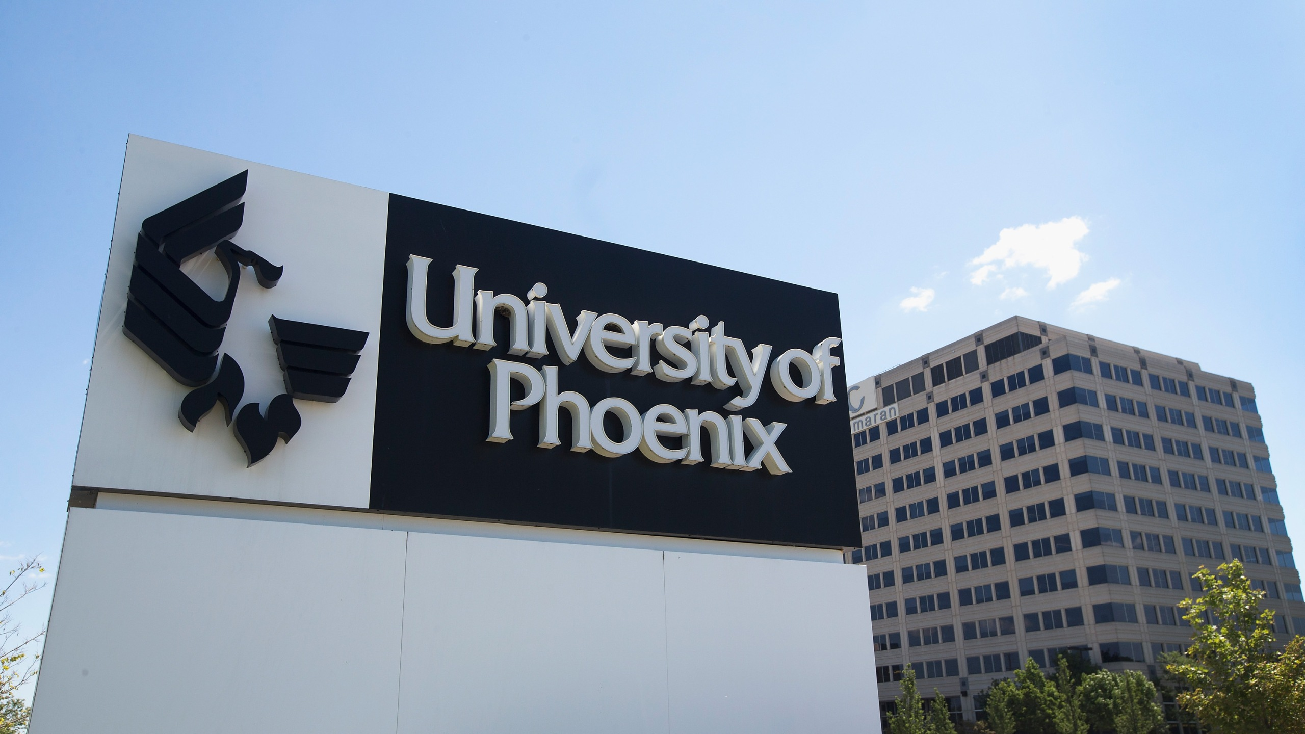 A sign marks the location of the University of Phoenix Chicago Campus on July 30, 2015 in Schaumburg, Illinois. (Credit: Scott Olson/Getty Images)
