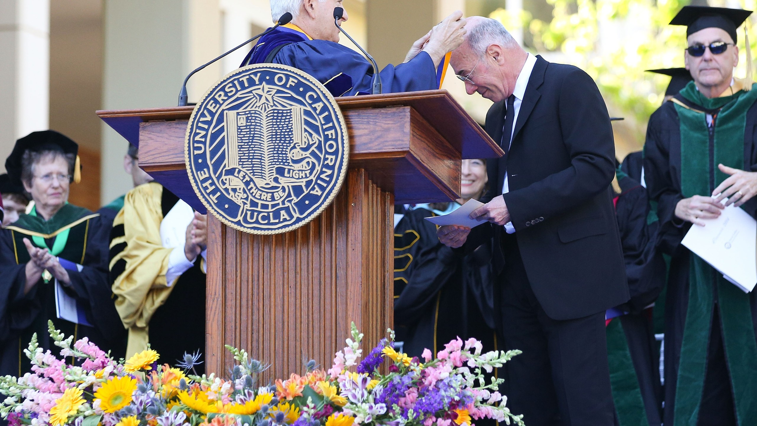 UCLA Chancellor Gene Block presents David Geffen with the UCLA Medal, the highest honor bestowed by the university, during the David Geffen School of Medicine at UCLAs Hippocratic Oath Ceremony on May 30, 2014 in Westwood. (Credit: Imeh Akpanudosen/Getty Images for UCLA)