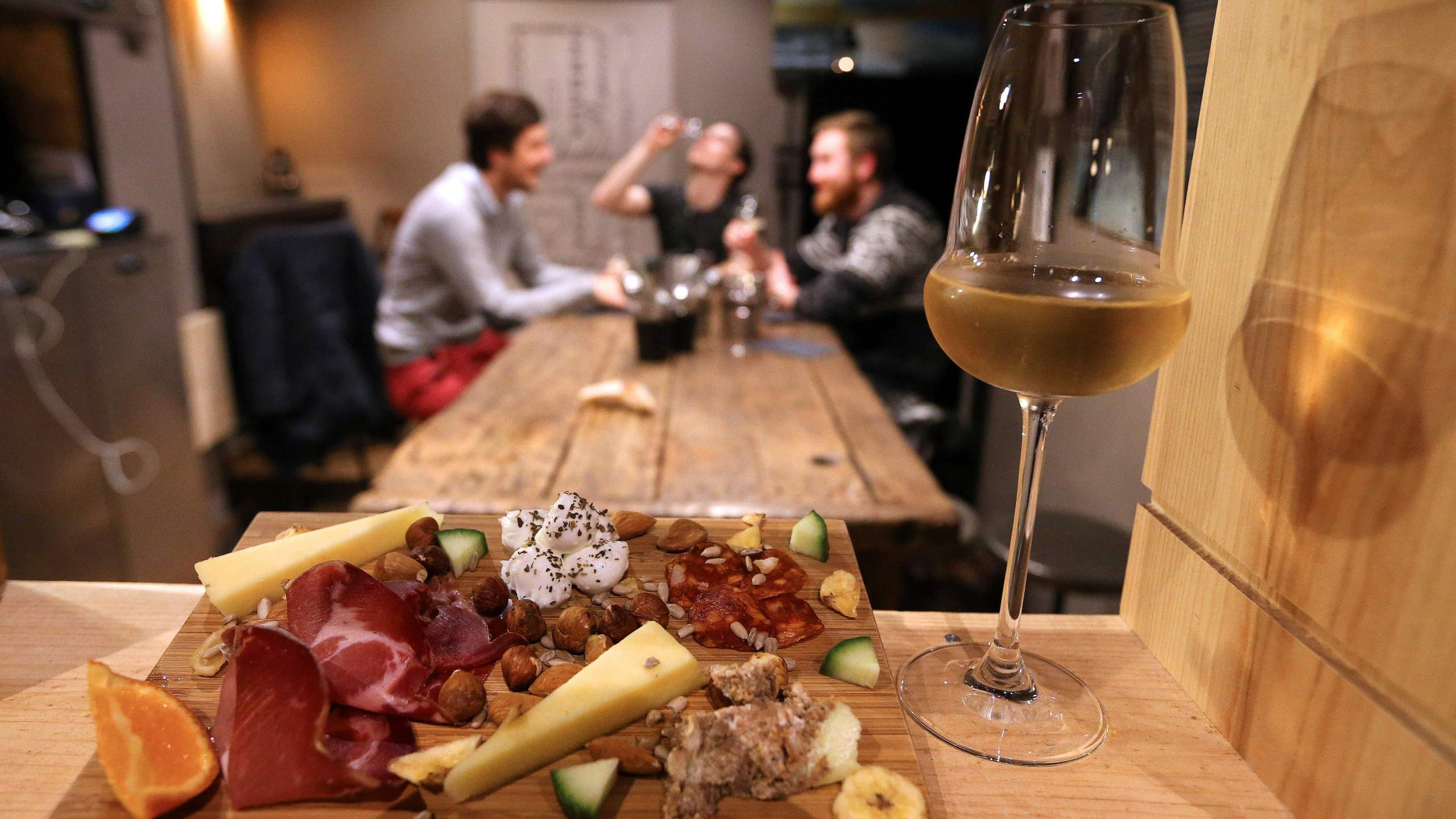 A glass of champagne is served with cheese and ham in Reims, northeastern France, on Dec. 20, 2016. (Credit: FRANCOIS NASCIMBENI/AFP via Getty Images)