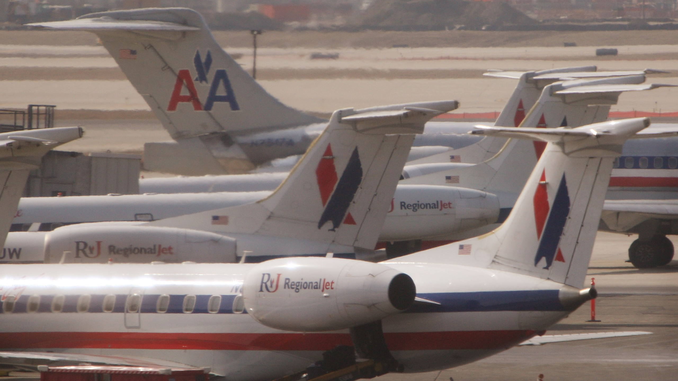 An American Airlines jet taxis past American Eagle jets in a March 2008 file photo. (Credit: Scott Olson/Getty Images)