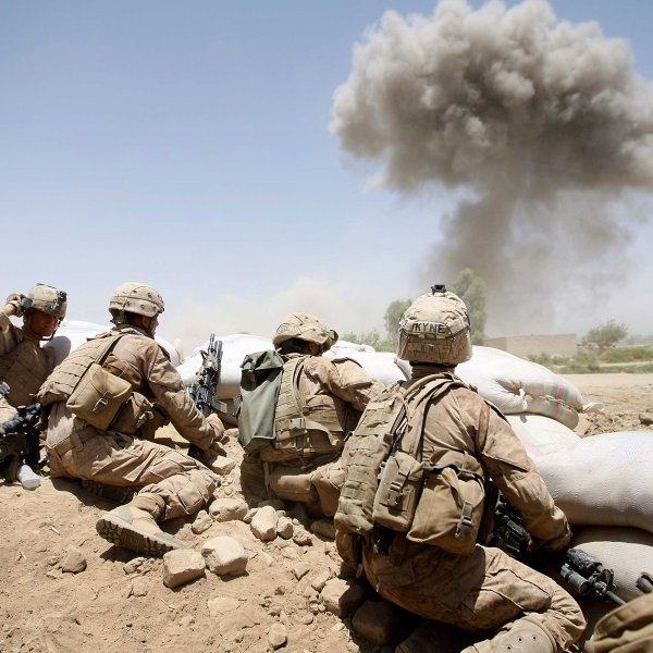 U.S. Marines take cover as a bomb explodes on a compound on July 3, 2009 in Main Poshteh, Afghanistan. (Credit: Joe Raedle/Getty Images)