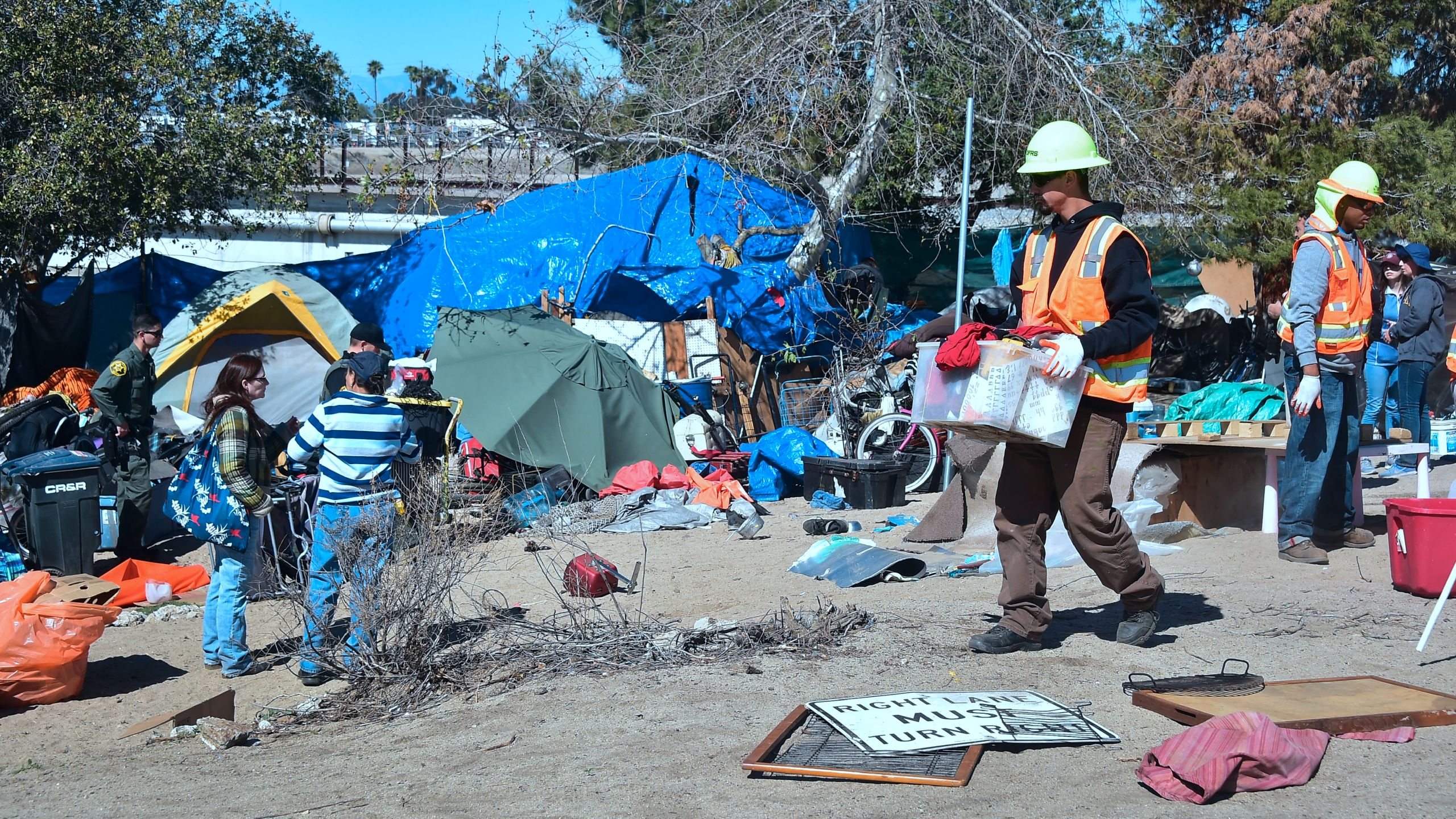 County workers clear a homeless encampment near the Santa Ana River on Feb.20, 2018, in Anaheim.(Credit: Frederic J. Brown/AFP via Getty Images)