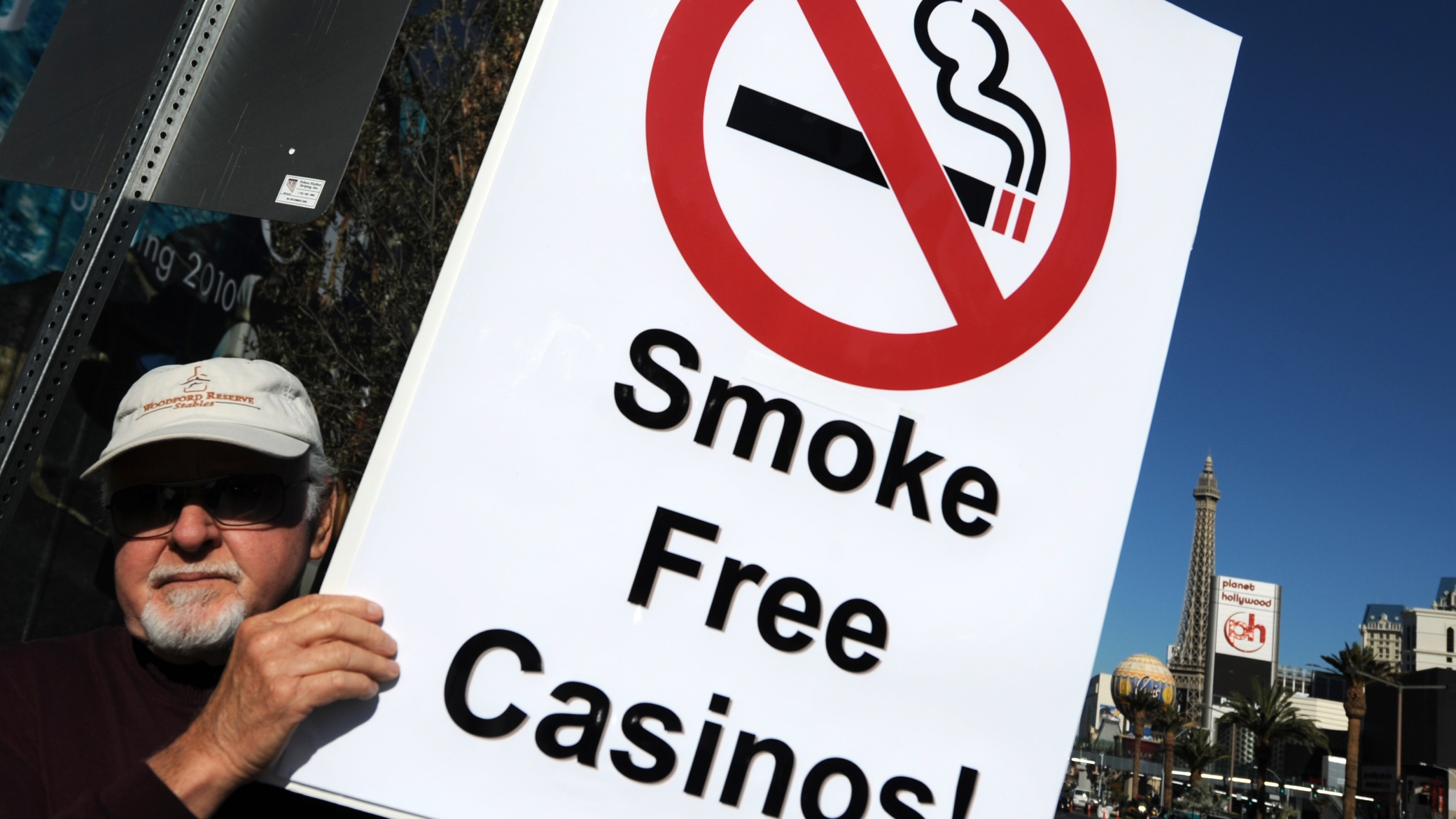 A man protests for smoke-free casinos in Las Vegas outside the CityCenter, a mixed-use urban development center on the Las Vegas Strip on Dec. 16, 2009. (Credit: GABRIEL BOUYS/AFP via Getty Images)