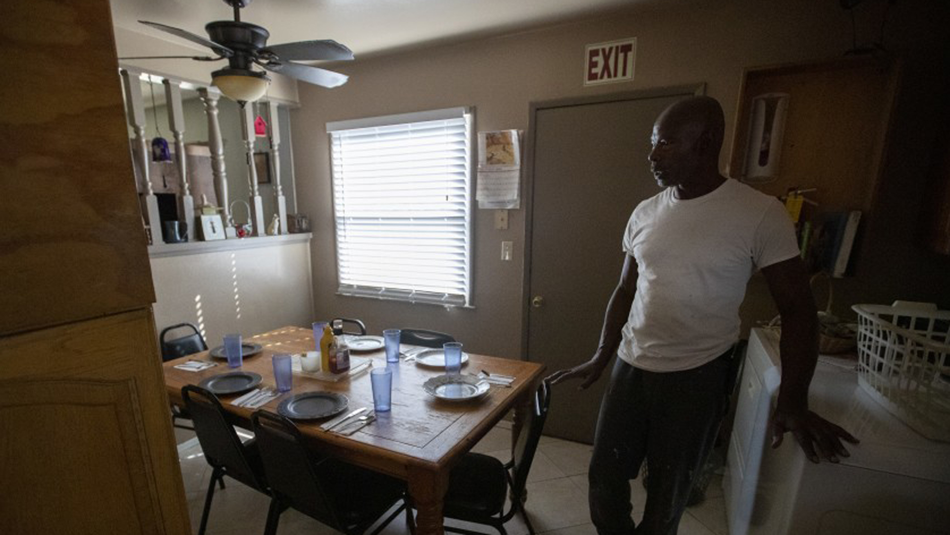 Sam Blake in the kitchen of the Blake Home, a board and care home that he runs with his mother and sister in Sylmar. A funding crisis could cause several such facilities to close across California, leaving residents homeless.(Credit: Brian van der Brug / Los Angeles Times)