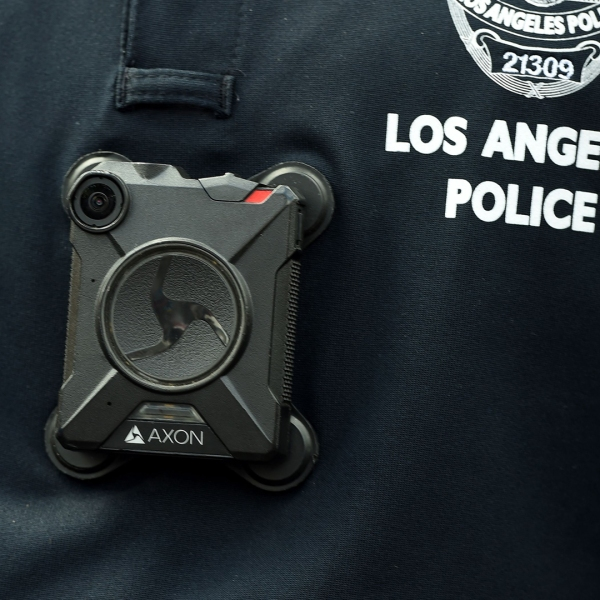 An LAPD officer wears a body camera at the Los Angeles Gay Pride Resist March, June 11, 2017, in Hollywood (Credit: ROBYN BECK/AFP via Getty Images)