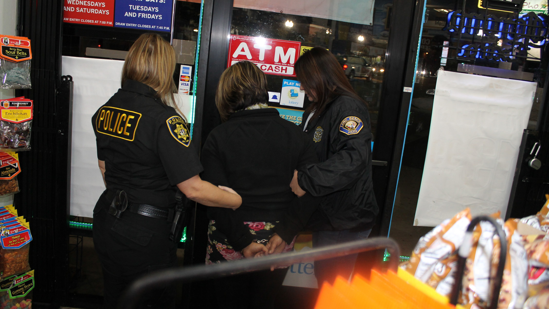 Long Beach police released this photo of Amor Potestades Amacio being taken into custody.