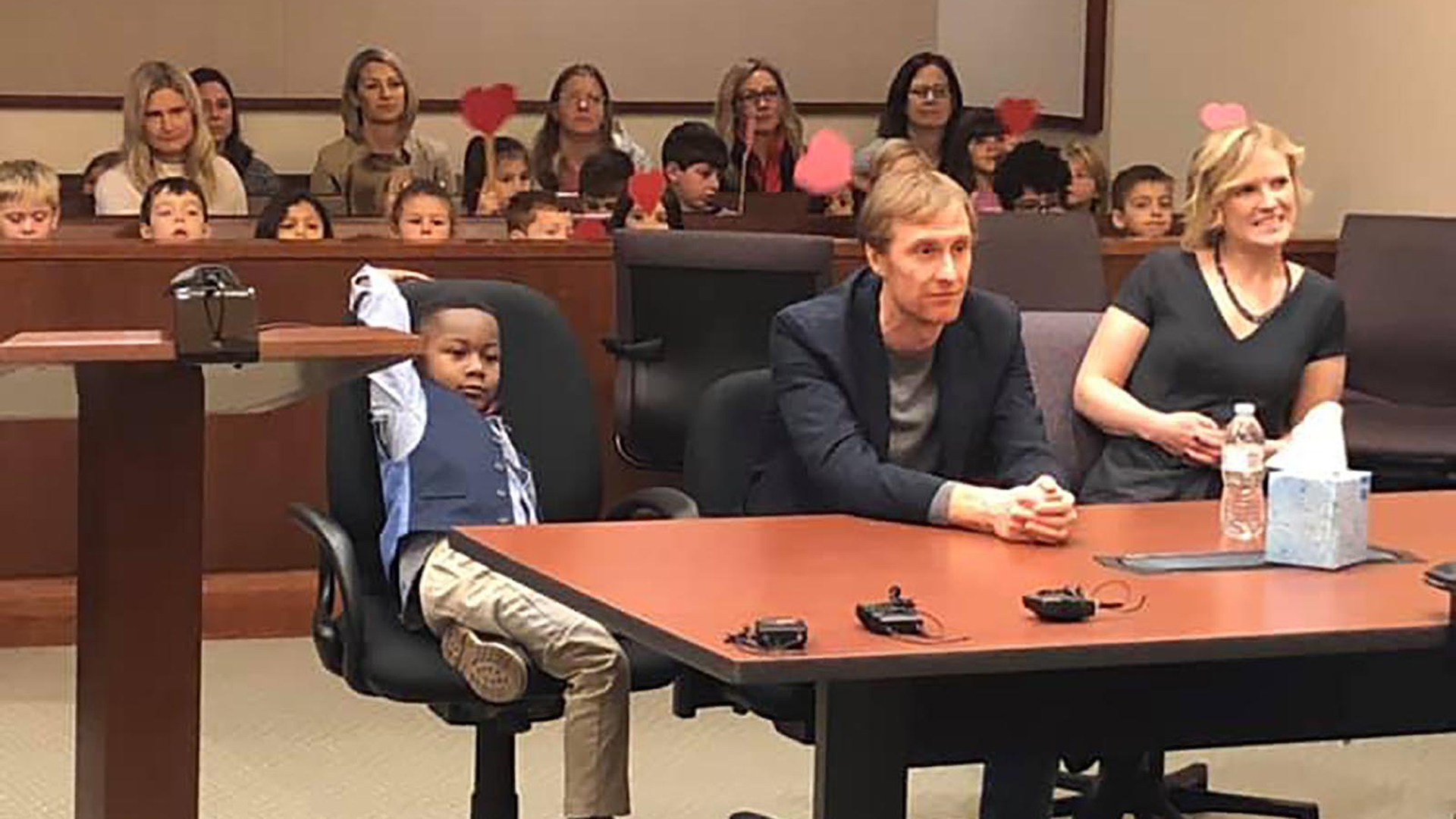 Five-year-old Michael's entire kindergarten class sat in the audience behind him waving big red hearts mounted on wooden sticks to show their support. (Credit: Kent County, Michigan)