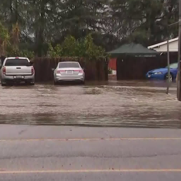 Flooding caused by a broken water main shut down Woodman Avenue from Devonshire Street to Lassen Street in the Woodland Hills and Arleta area on Dec. 4, 2019.(Credit: KTLA)