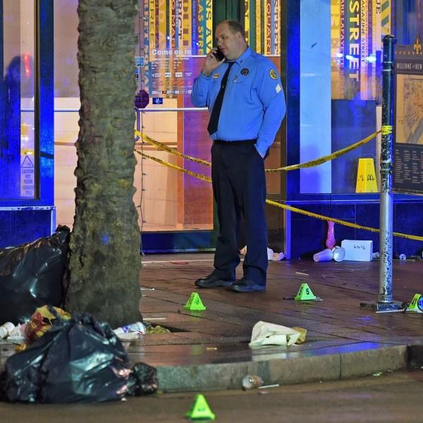Police investigate the shooting scene Dec. 1, 2019.