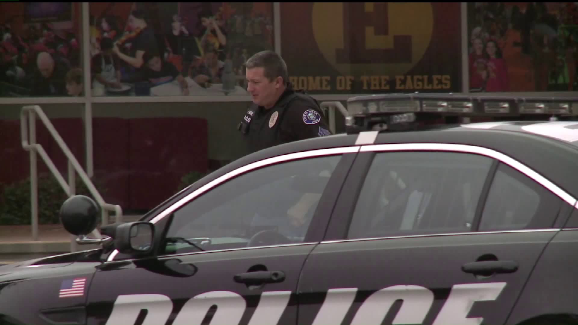 A police officer is seen on the campus of Estancia High School in Costa Mesa on Dec. 3, 2019. (Credit: KTLA)