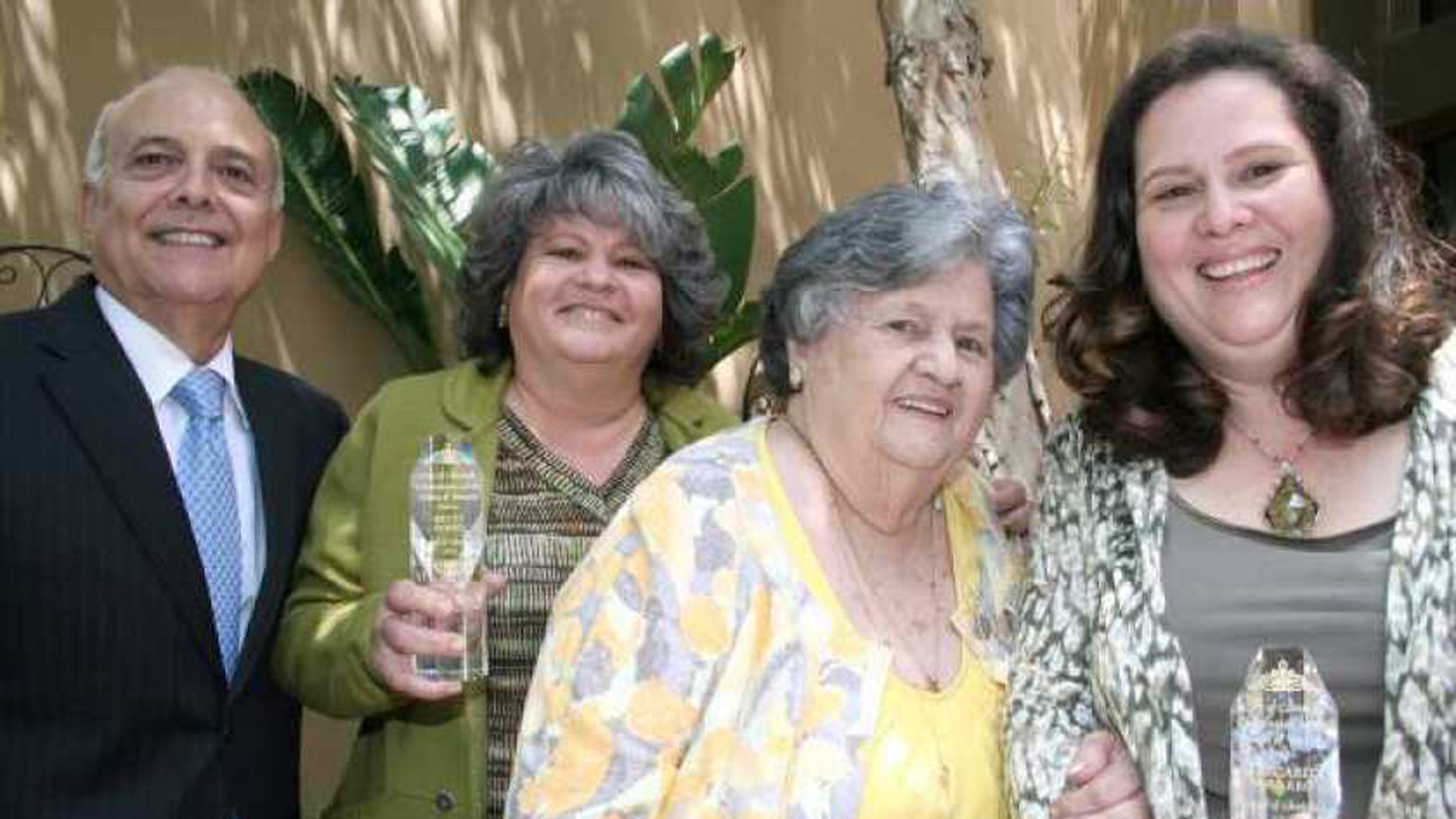 "Former Glendale Mayor Frank Quintero poses with Betty Porto, mother Rosa Porto and Margarita Navarro during an awards luncheon in 2012. Rosa Porto was honored as a ""Jewel of Glendale"" for her service to the community. (Credit: Los Angeles Times)"