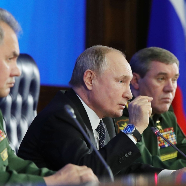 Russian President Vladimir Putin (C) and Russian Defence Minister Sergei Shoigu (L) take part in the annual meeting of the Defence Ministry board, in Moscow on December 24, 2019. (Credit: Mikhail Klimentyev/Sputnik/AFP via Getty Images)