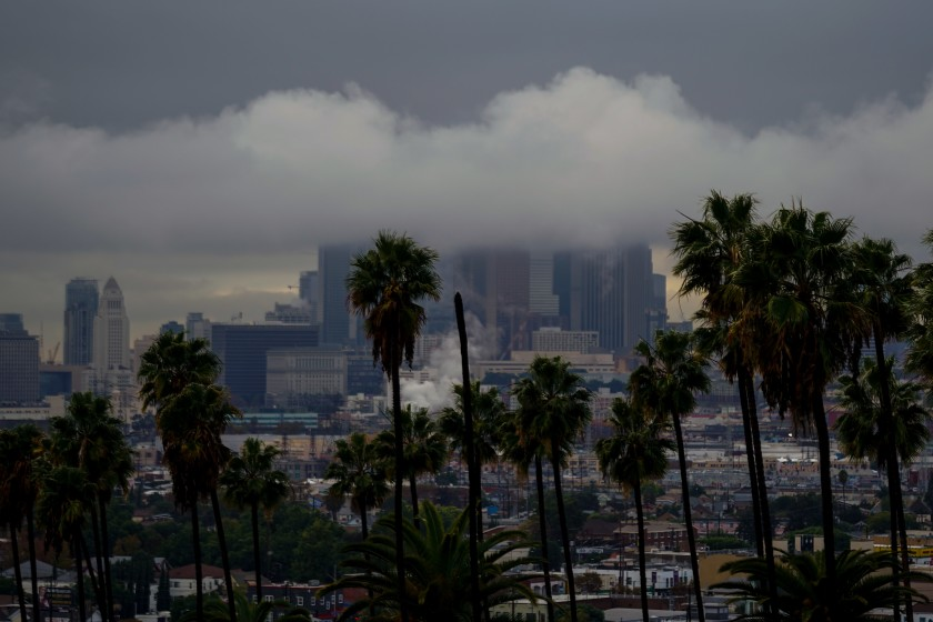 Low-hanging clouds blanket downtown L.A. as seen above Ela Park in Lincoln Heights on Dec. 4, 2019. (Credit: Kent Nishimura / Los Angeles Times)