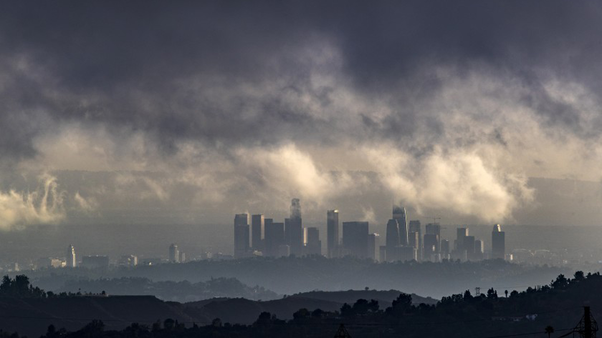 Clouds linger over downtown L.A. skyscrapers as a storm rolls through the Los Angeles basin last week. (Credit: Brian van der Brug / Los Angeles Times)