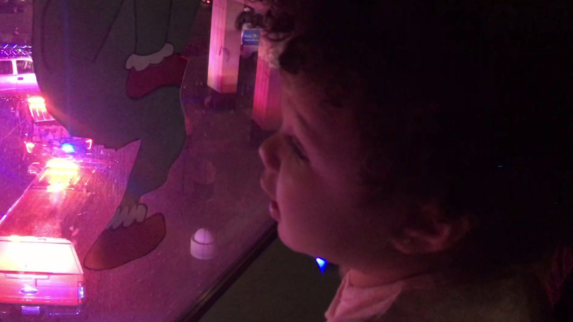 A patient at Shriners Hospitals for Children in Sacramento watches a light show produced by local police and firefighters on Dec. 17, 2019. (Credit: KTXL)