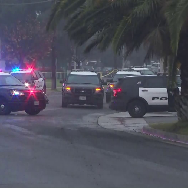 Ontario police respond to a home where a suspected shooter is believed to be holed up with her children on Dec. 14, 2019. (Credit: KTLA)