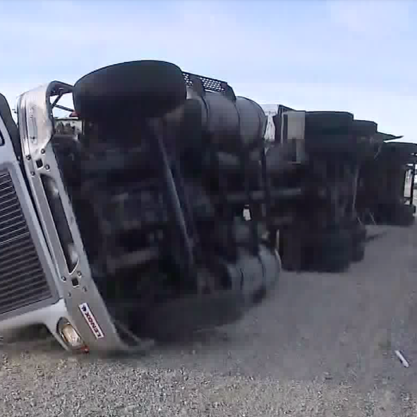 The powerful Santa Ana winds knocked over a big rig on the northbound 15 Freeway in Fontana on Dec. 17, 2019. (Credit: KTLA)