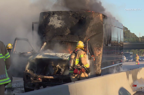 OCFA firefighters put out a party bus fire on the 405 Freeway in Irvine on Dec. 31, 2019. (Credit: OnScene.TV)