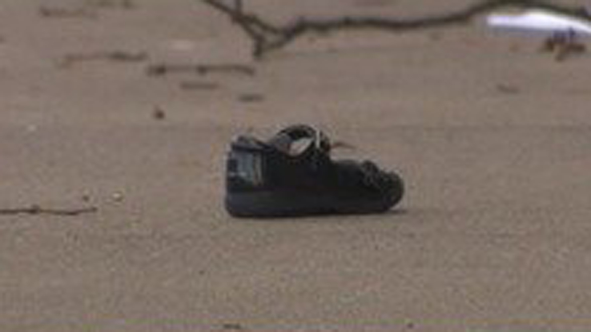 A child's shoe is seen at the scene where a woman and two young children were found dead on Dec. 25, 2019. (Credit: WBZ via CNN)