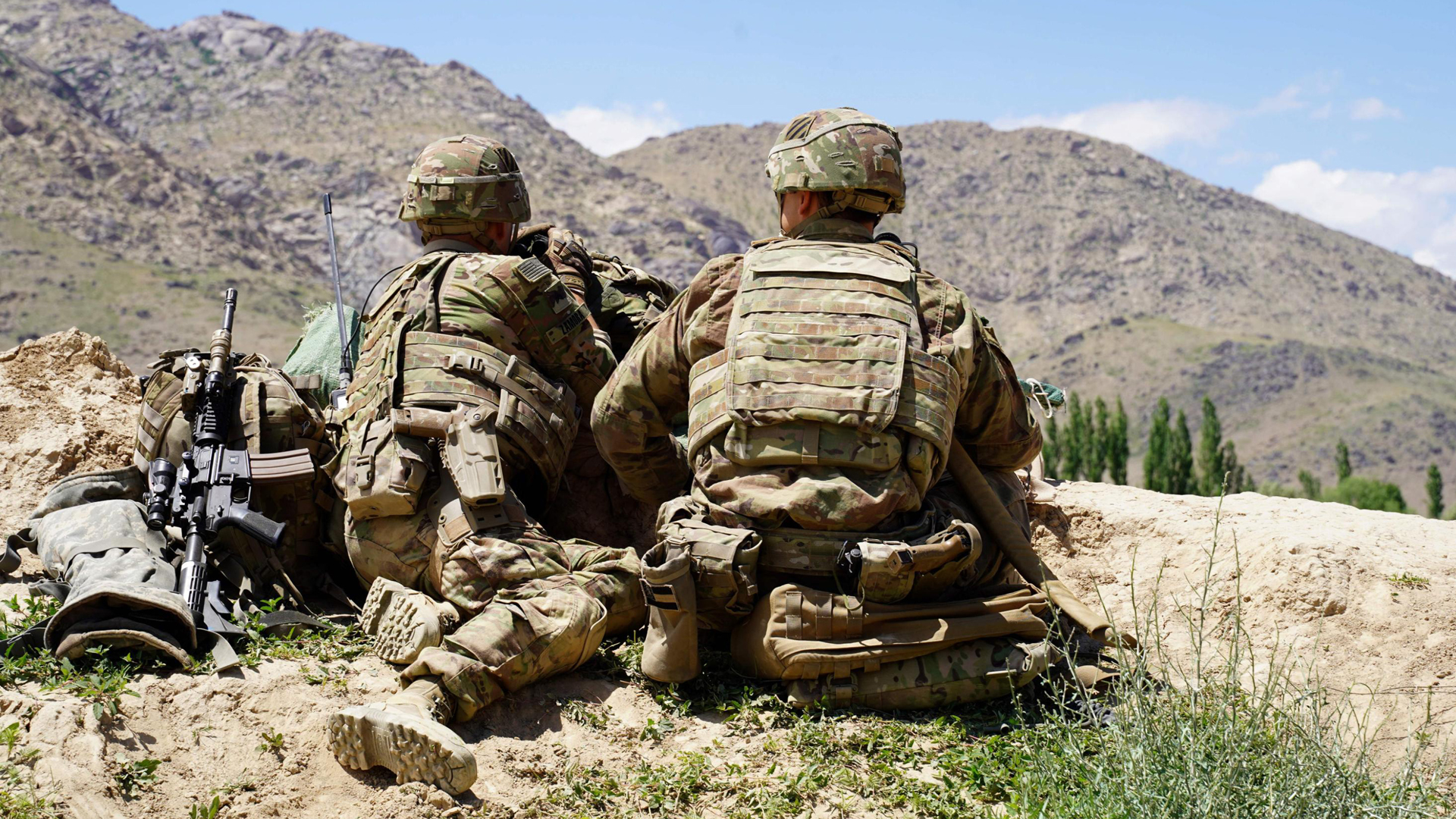 In this photo taken on June 6, 2019, U.S. soldiers look out over hillsides during a visit of the commander of U.S. and NATO forces in Afghanistan General Scott Miller at the Afghan National Army checkpoint in Nerkh district of Wardak province. (Credit: THOMAS WATKINS/AFP via Getty Images)