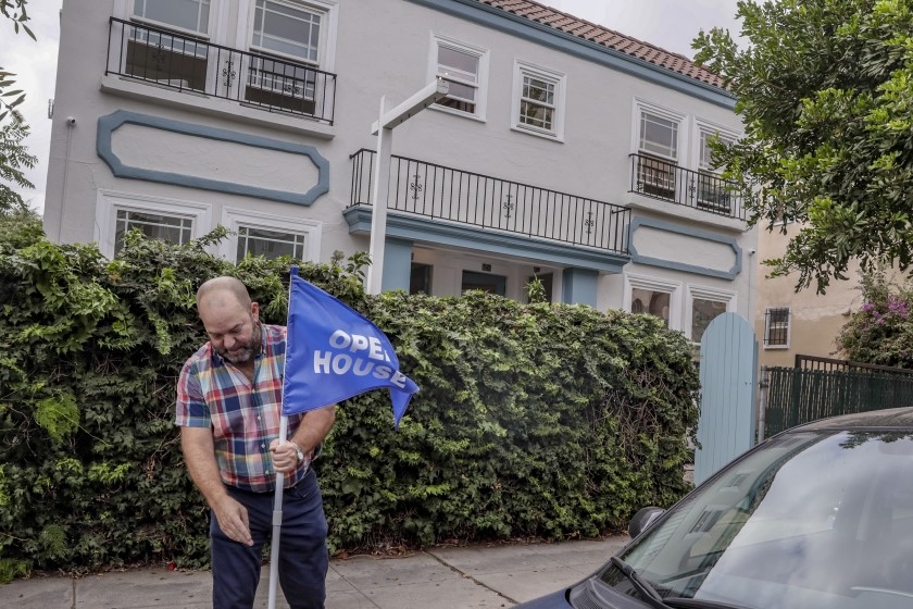 Real estate agent and developer Christopher Stanley prepares an open house at Hollywood fourplex being sold as a tenancy-in-common development in this undated photo. (Credit: Robert Gauthier/Los Angeles Times)