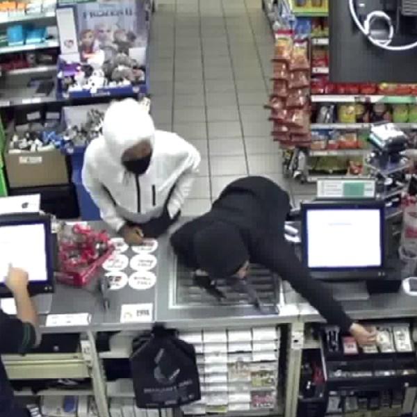 Surveillance video shows two men rob a 7-Eleven in Northridge at gunpoint on Dec. 20, 2019.