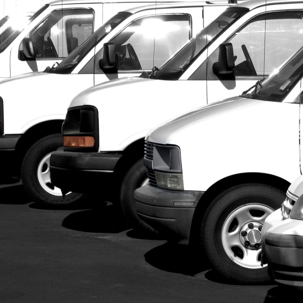 White vans are seen parked in this file photo. (Credit: Shutterstock via CNN)