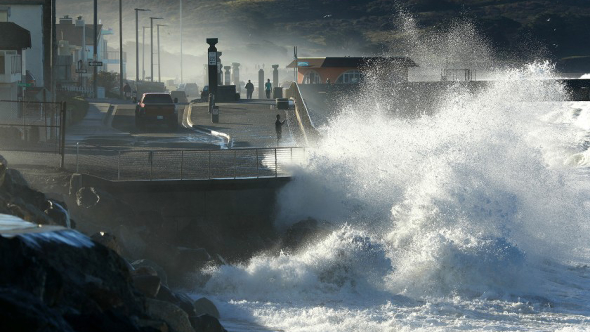 A wave pounds the shores of Pacifica during high tide. Cities up and down the California coast are grappling with the costs and consequences of living by the sea.(Credit: Carolyn Cole / Los Angeles Times)
