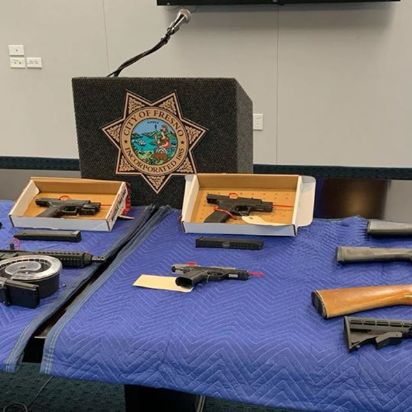 Fresno police released this photo on Dec. 31, 2019, of weapons seized as they announced the arrest of six people suspected of killing four men at a backyard party in Fresno last month.