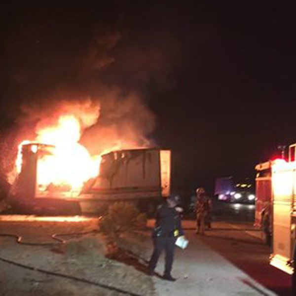 Two people died in a fiery collision between two big rigs on the 15 Freeway south of Barstow on Jan. 19, 2020. (Credit: San Bernardino County Fire Department)