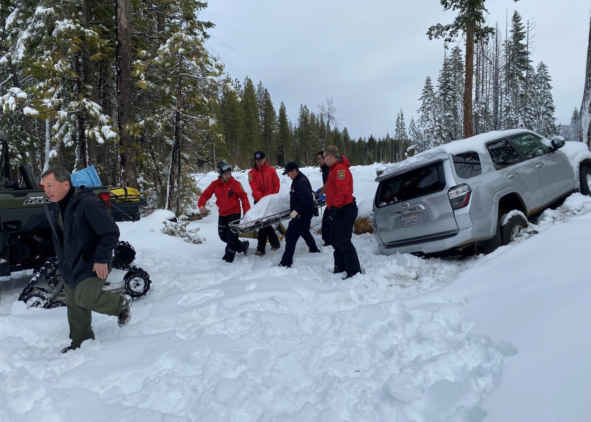 Paula Beth James is rescued from her snow-covered car on Jan. 15, 2020, after having been missing for six days in Butte Meadows. (Credit: Butte County Sheriff's Office.)