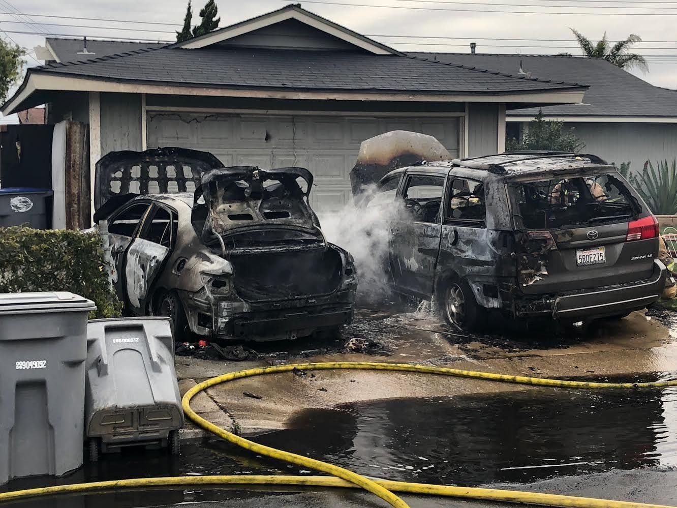 Two vehicles stand gutted outside an Oxnard home on Jan. 20, 2020, in a photo released by the Oxnard Police Department.