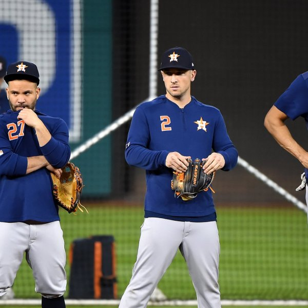 Jose Altuve #27, Alex Bregman #2 and Carlos Correa #1 of the Houston Astros looks on during batting practice prior to Game Three of the 2019 World Series against the Washington Nationals at Nationals Park on October 25, 2019 in Washington, DC. (Credit: Will Newton/Getty Images)