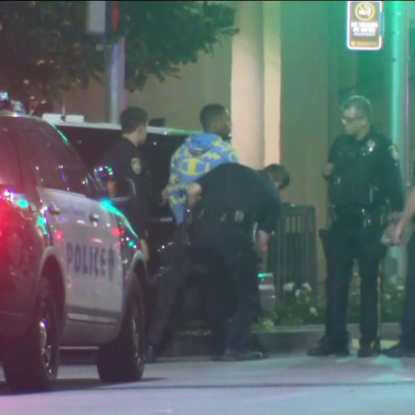Police arrested a suspect in connection with a robbery, in which a gun was fired, along Beverly Boulevard in Beverly Hills on Jan. 11, 2020. (Credit: KTLA)