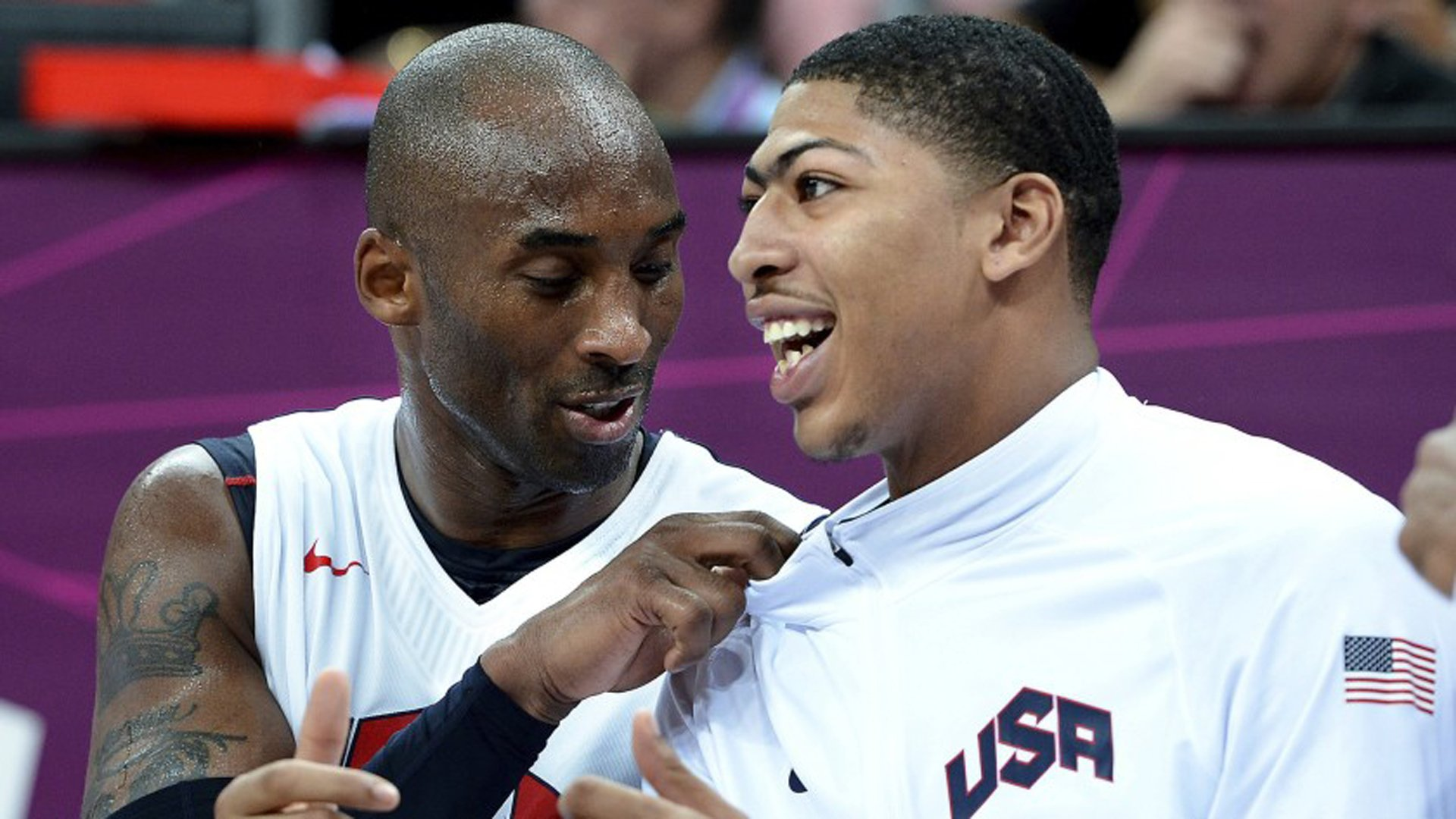Kobe Bryant, left, and Anthony Davis talk while sitting on the bench during a game at the 2012 London Olympics.(Credit: Wally Skalij / Los Angeles Times)