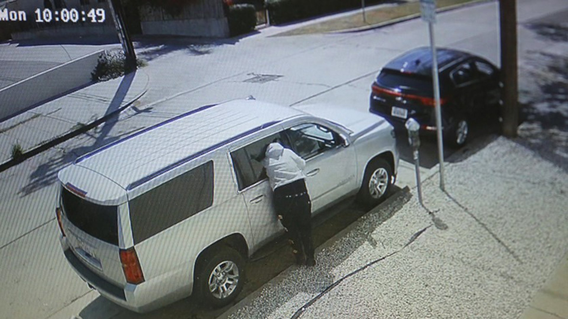 A person burglarizes a vehicle in broad daylight and is caught on video at La Jolla and Melrose avenues in Los Angeles.(Credit: Genaro Molina / Los Angeles Times)