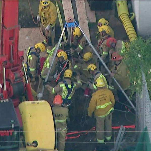 Firefighters rescue a man from a construction site on Jan. 2, 2019 in Wet Hollywood. (Credit: Sky5)