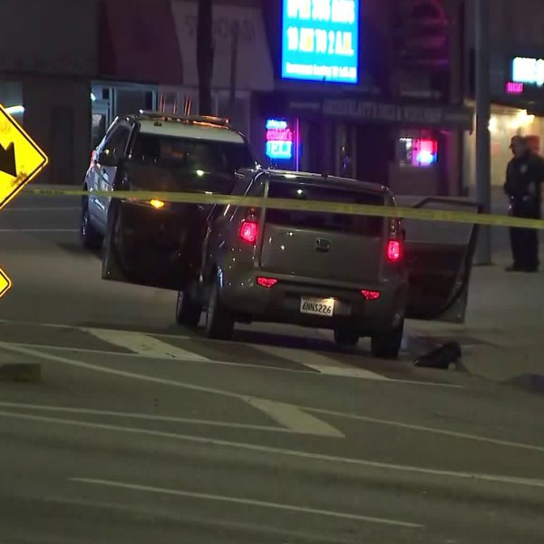 Officers investigate after a person was found suffering from a gunshot wound in the Hollywood area on Jan. 23, 2020. (Credit: KTLA)