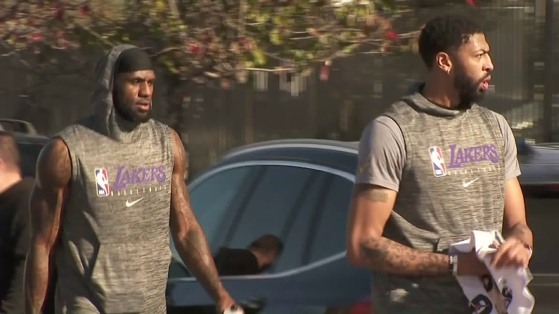 LeBron James, left, and Anthony Davis walk to the Los Angeles Lakers' practice facility in El Segundo on Jan. 29, 2020. (Credit: KTLA)