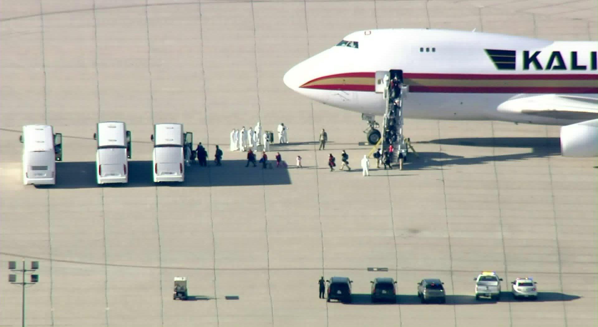 U.S. evacuees from China arrive at March Air Reserve Base near Riverside on Jan. 29, 2020, after passenger screenings in Alaska. (Credit: KTLA)