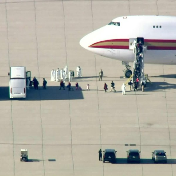 U.S. evacuees from China arrive at March Air Reserve Base near Riverside on Jan. 29, 2020, after passenger screenings in Alaska. (Credit: KTLA)