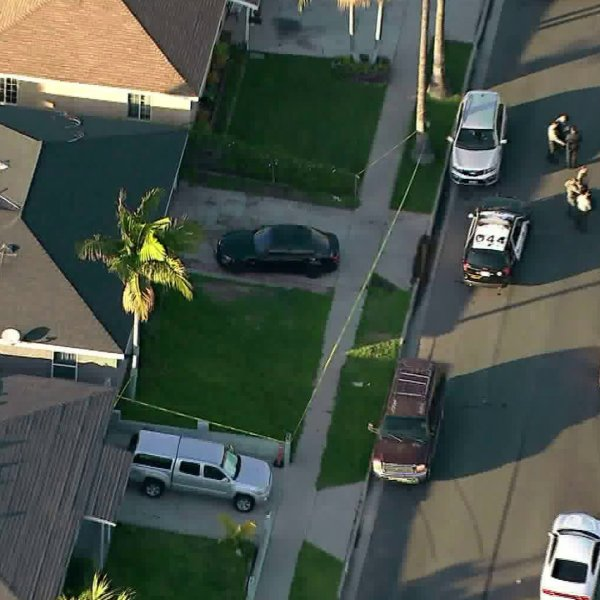 Deputies respond to the home where a woman was fatally shot in Carson on Jan. 17, 2020. (Credit: KTLA)