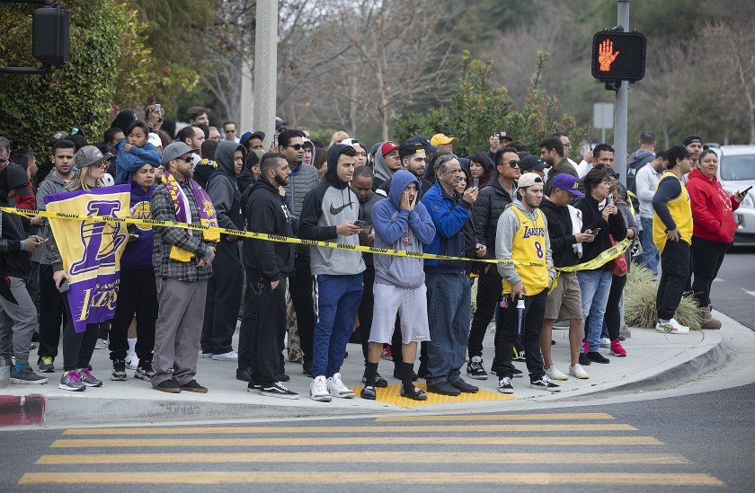 People gather on Las Virgenes Road in Calabasas near the scene of the helicopter crash that killed Kobe Bryant and eight others in January 2020. (Credit: Mel Melcon / Los Angeles Times)