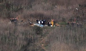 Officials assess the wreckage of the helicopter crash that killed Kobe Bryant, his 13-year-old daughter Gigi and seven others on Jan. 26, 2020 in Calabasas. (Credit: Christina House / Los Angeles Times)