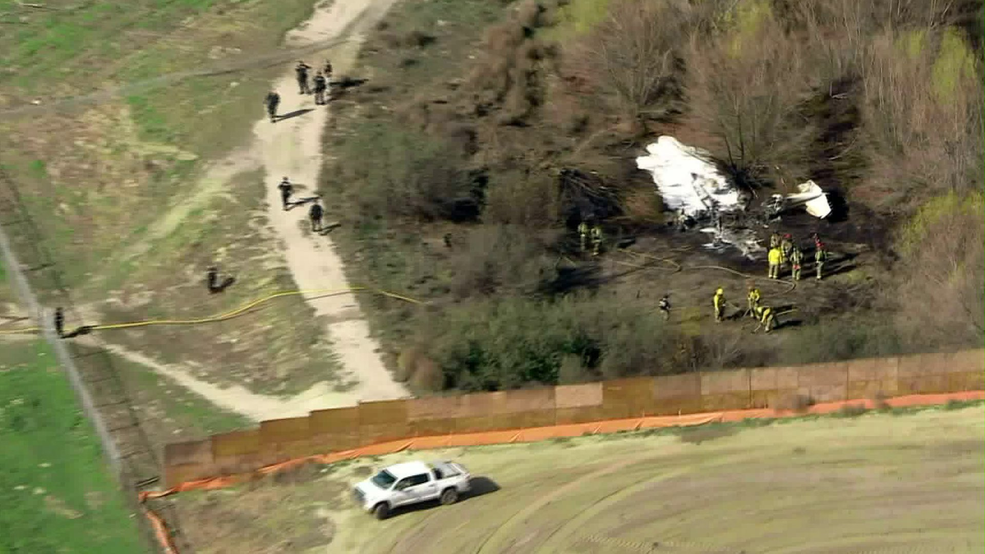 Firefighters respond to a plane crash in Corona on Jan. 22, 2020. (Credit: KTLA)