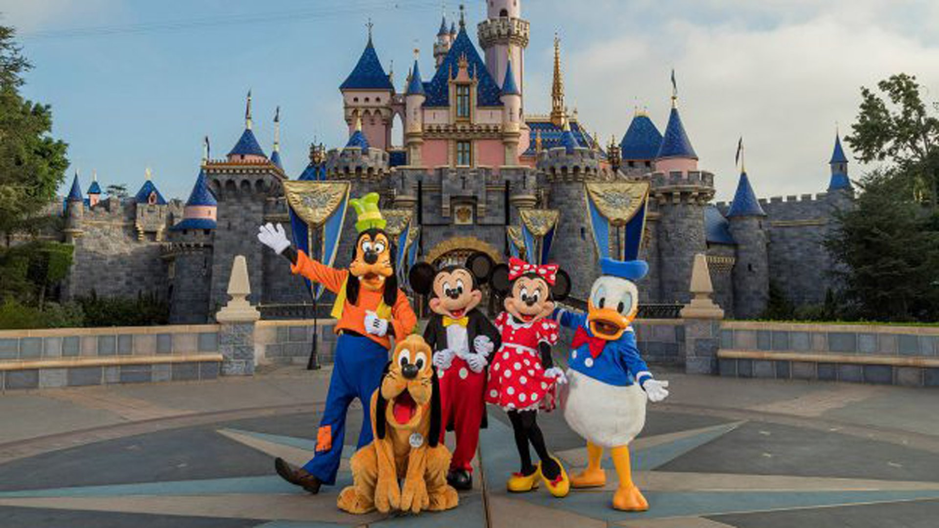 Disney characters are seen in front of Sleeping Beauty's Castle at Disneyland in a photo released by Disney on Jan. 7, 2020.