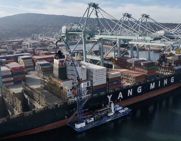 """A barge at the Port of Los Angeles uses a system, known as a bonnet or """"sock on a stack,"""" that's intended to scrub exhaust in December 2019. (Credit: Allen J. Schaben / Los Angeles Times)"""
