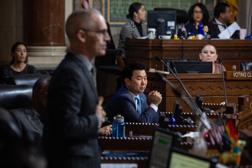 City Councilman Mitch O'Farrell, left, speaks before the council, addressing Councilman David Ryu, center, ahead of a vote to restrict campaign contributions from real estate developers.(Credit: Jason Armond/Los Angeles Times)