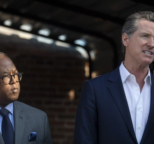 L.A. County Supervisor Mark Ridley-Thomas, left, and California Gov. Gavin Newsom appear at a news conference during their visit to the Lone Star Board and Care home in Los Angeles on Jan. 14, 2020.(Credit: Francine Orr / Los Angeles Times)