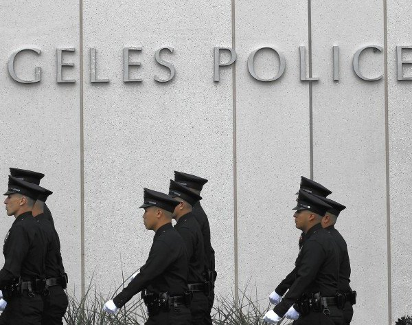 Several LAPD officers are seen outside the station in this undated photo. (Brian van der Brug / Los Angeles Times)